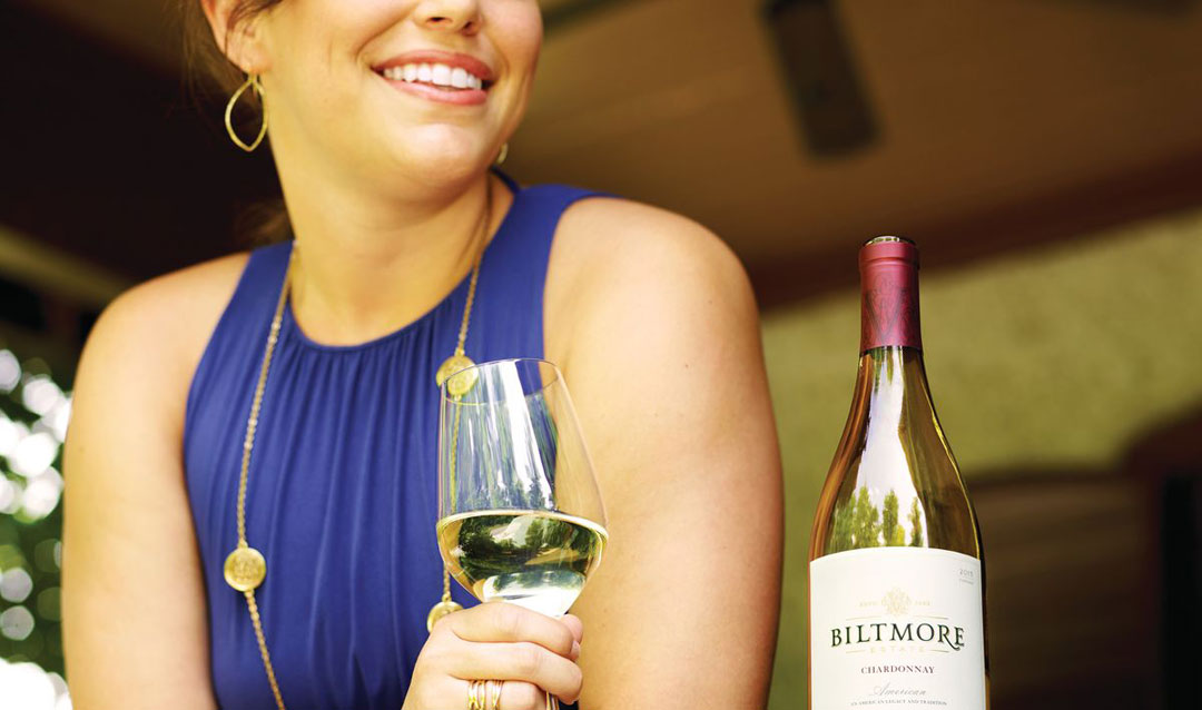 Woman enjoying Biltmore Estate Chardonnay