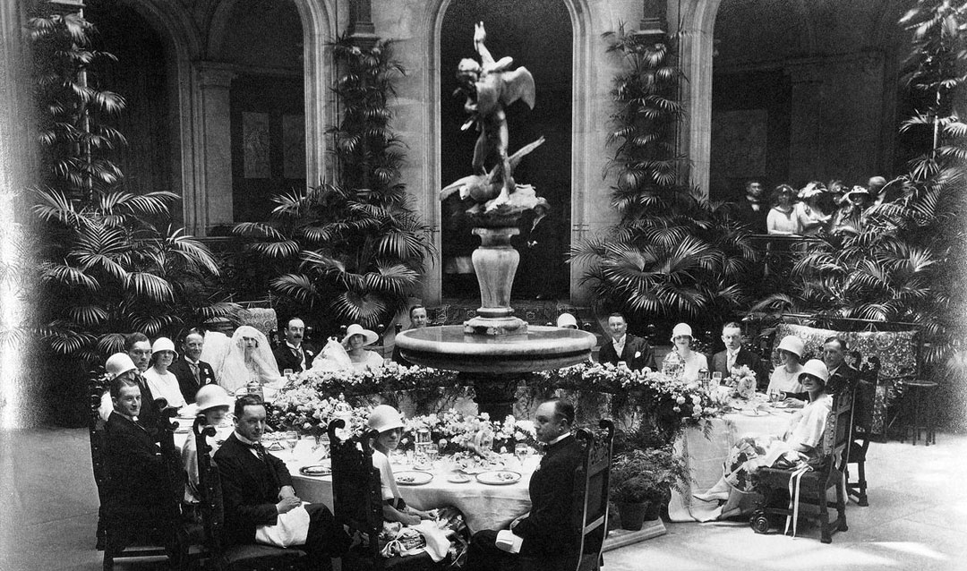 John and Cornelia Cecil wedding party at breakfast in the Winter Garden of Biltmore House