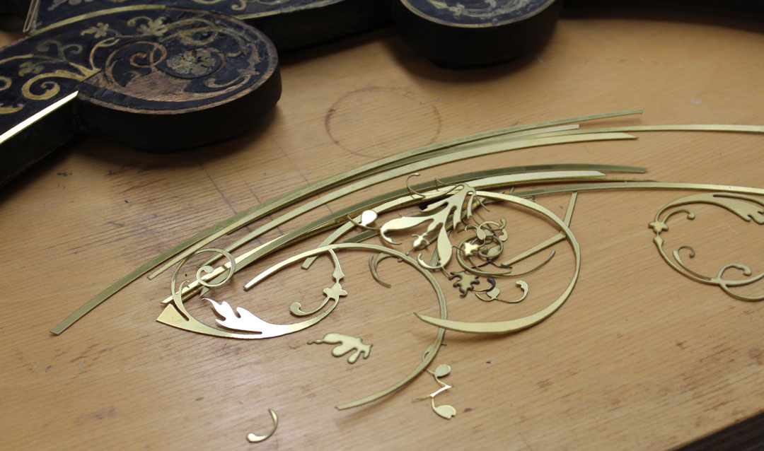 Pieces of brass marquetry for the desk
