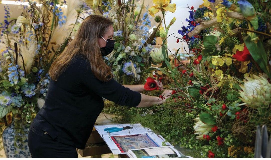 A Biltmore floral designer creates an arrangement for the Banquet Hall