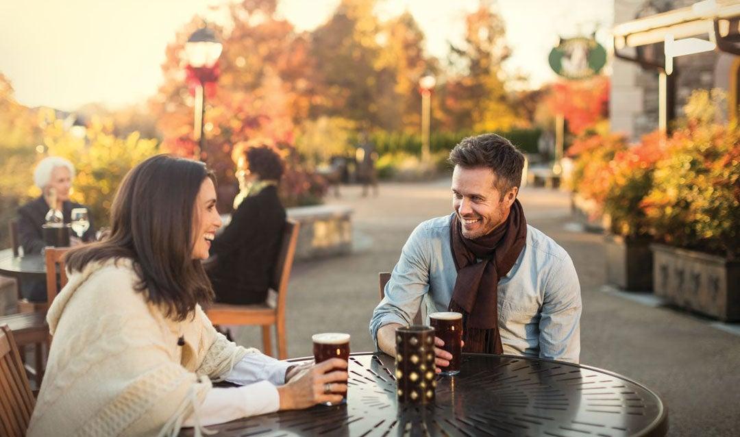 Couple enjoying fall at Antler Hill Village