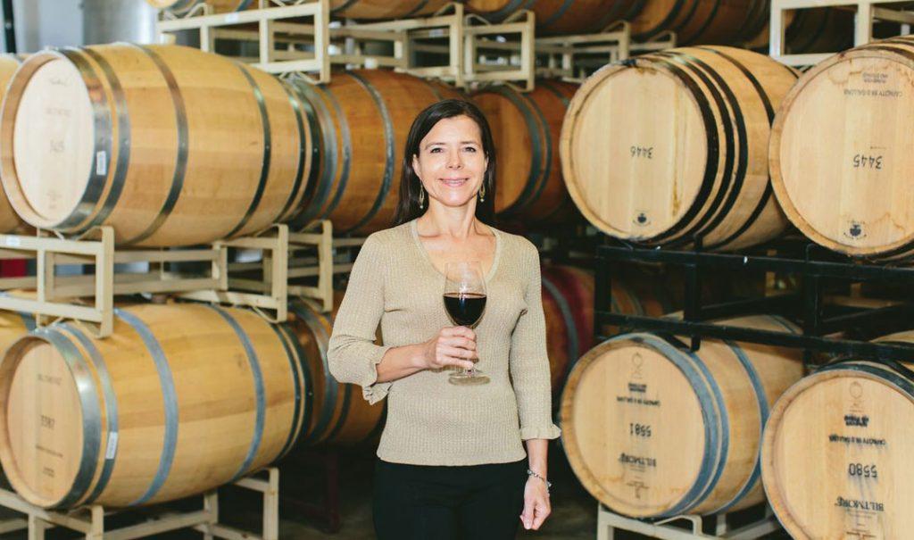 Biltmore winemaker Sharon Fenchak with wine barrels