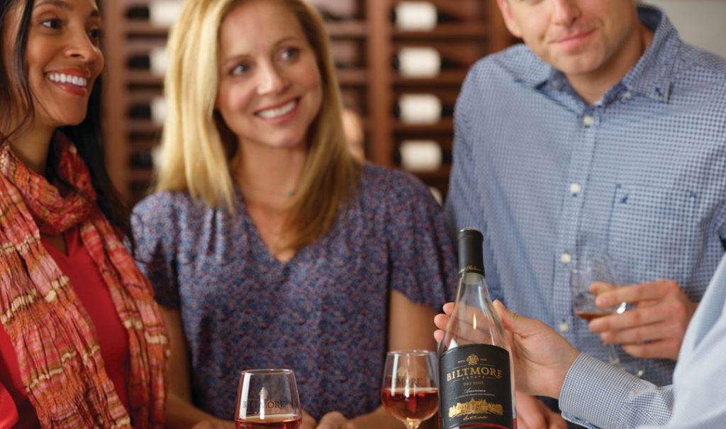 Guests enjoying a wine tasting at Biltmore Winery