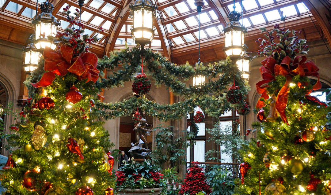 Winter Garden in Biltmore House decorated for Christmas at Biltmore