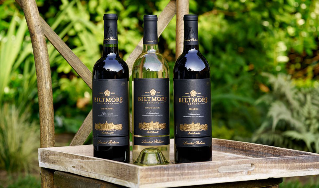 Three bottles of Biltmore Estate Limited Release wine on a chair