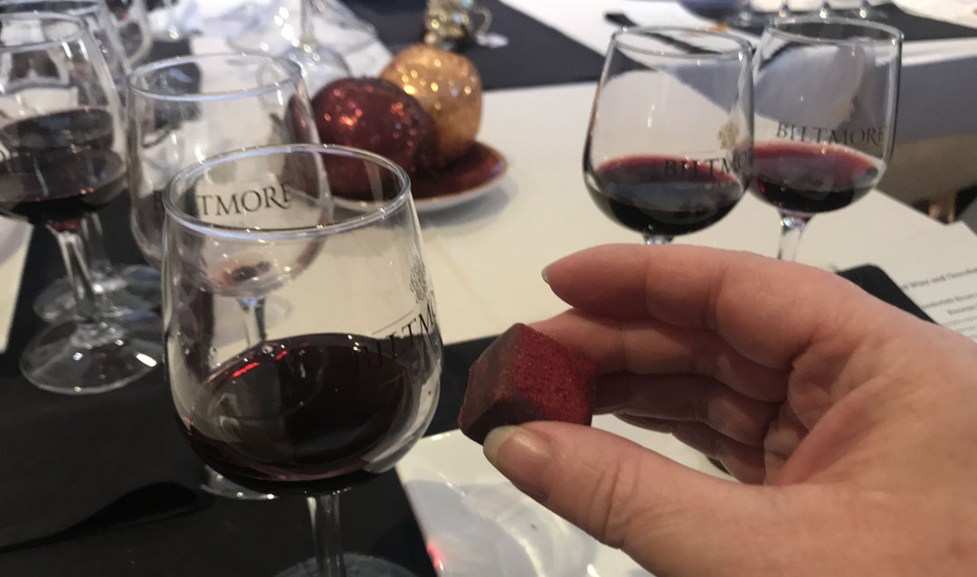 Glass of Biltmore red wine and a chocolate truffle