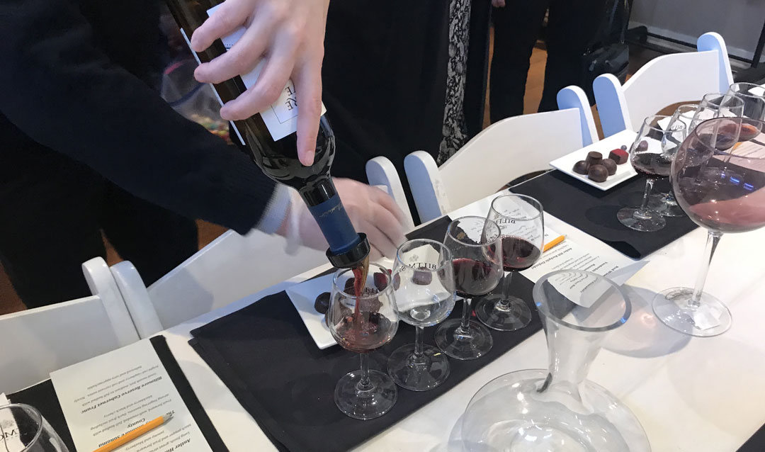 Pouring red wines for the Red Wine and Chocolate Tasting