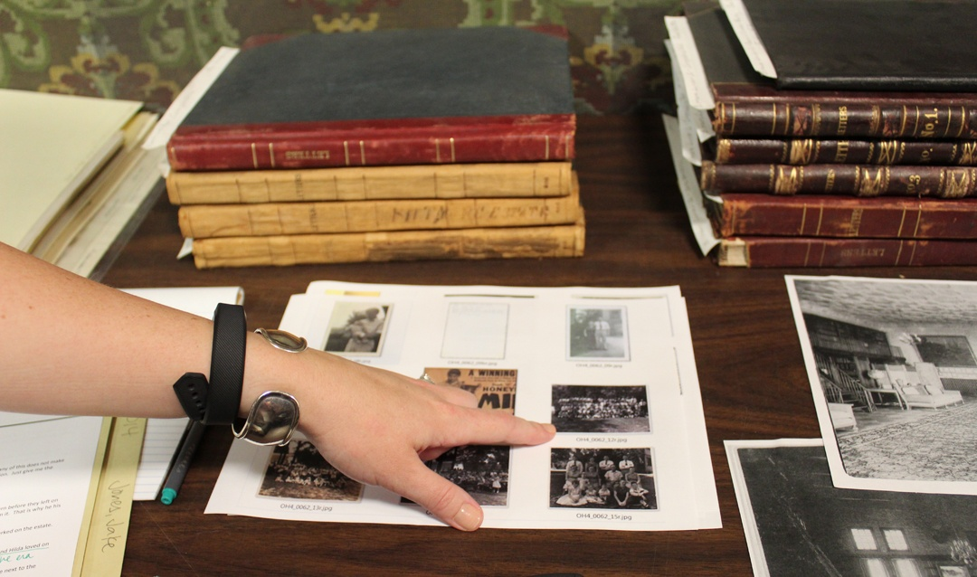 Curator's pointing at documents