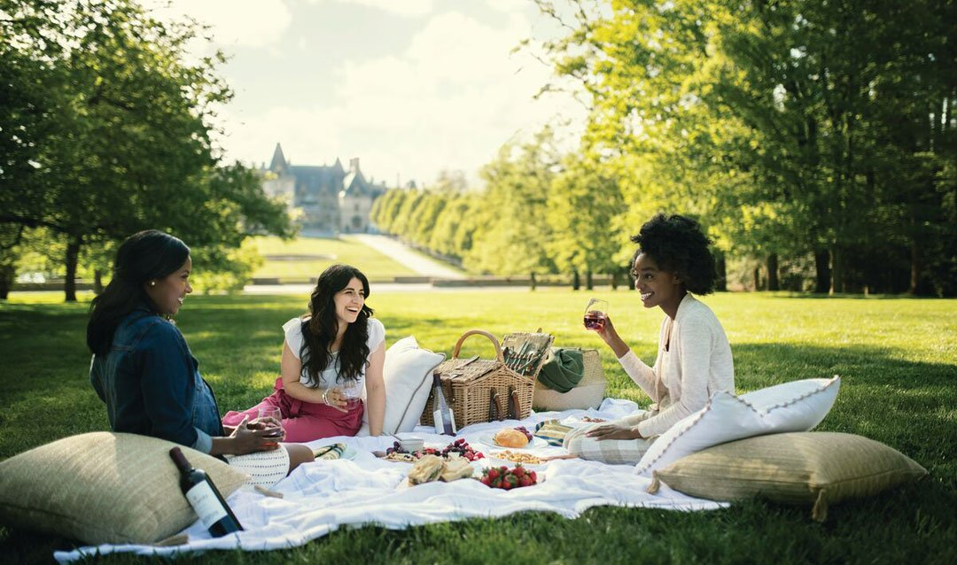 Ladies enjoying a warm weather picnic with wine at Biltmore House