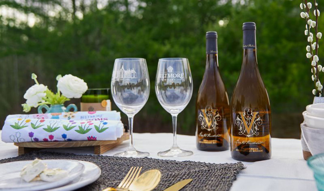 Biltmore Winery 35th Anniversary Chardonnay on a table with glasses