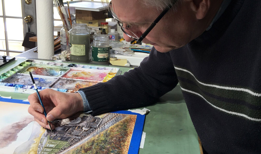 The artist at work on the label in his studio