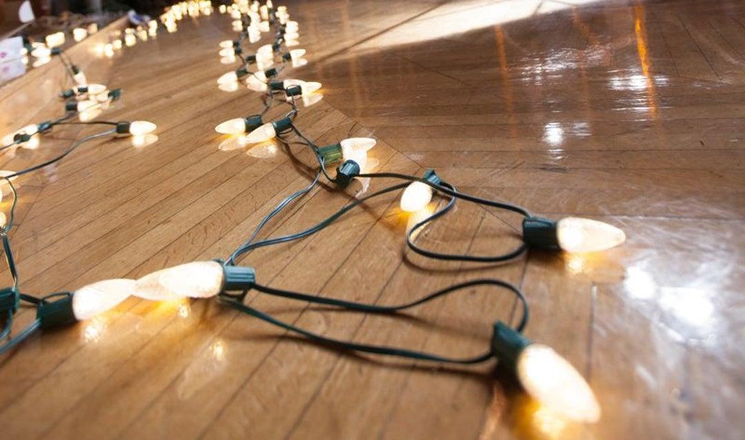 Christmas lights lay across the floor