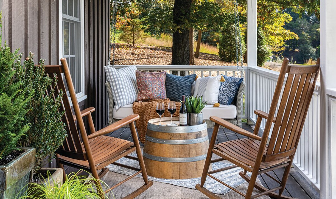 Charming front porch with swing and rocking chairs