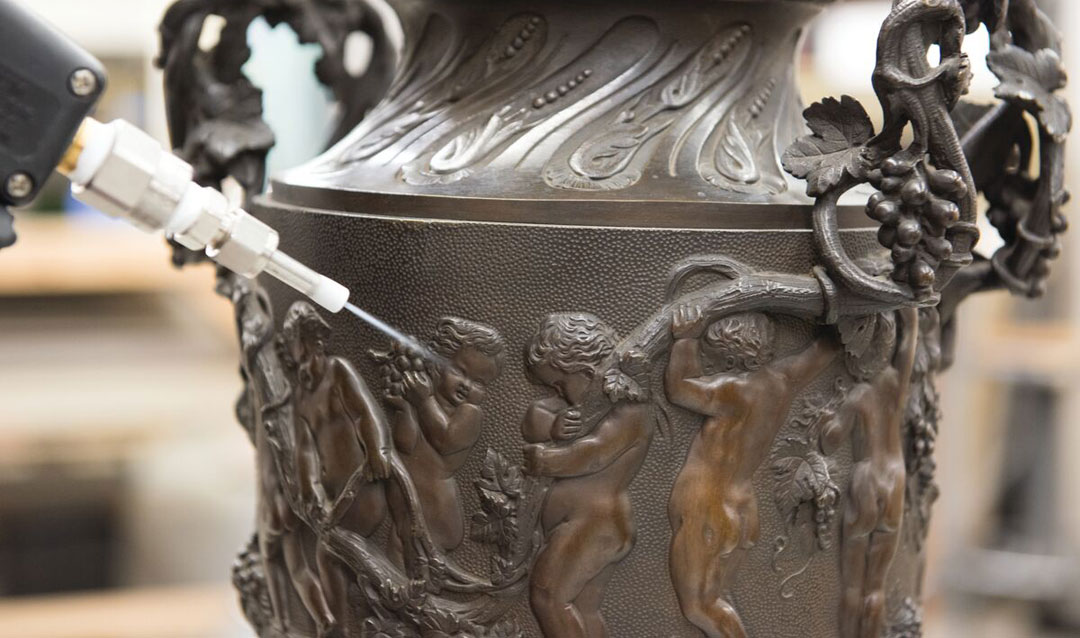 Bronze lamp being cleaned