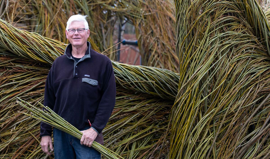 Patrick Dougherty with his Stickwork creation for Biltmore
