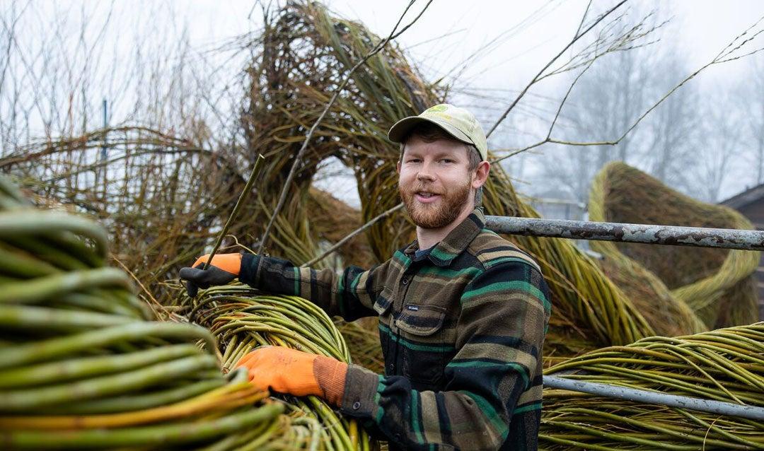 Sam Dougherty works on Stickwork creation for Biltmore