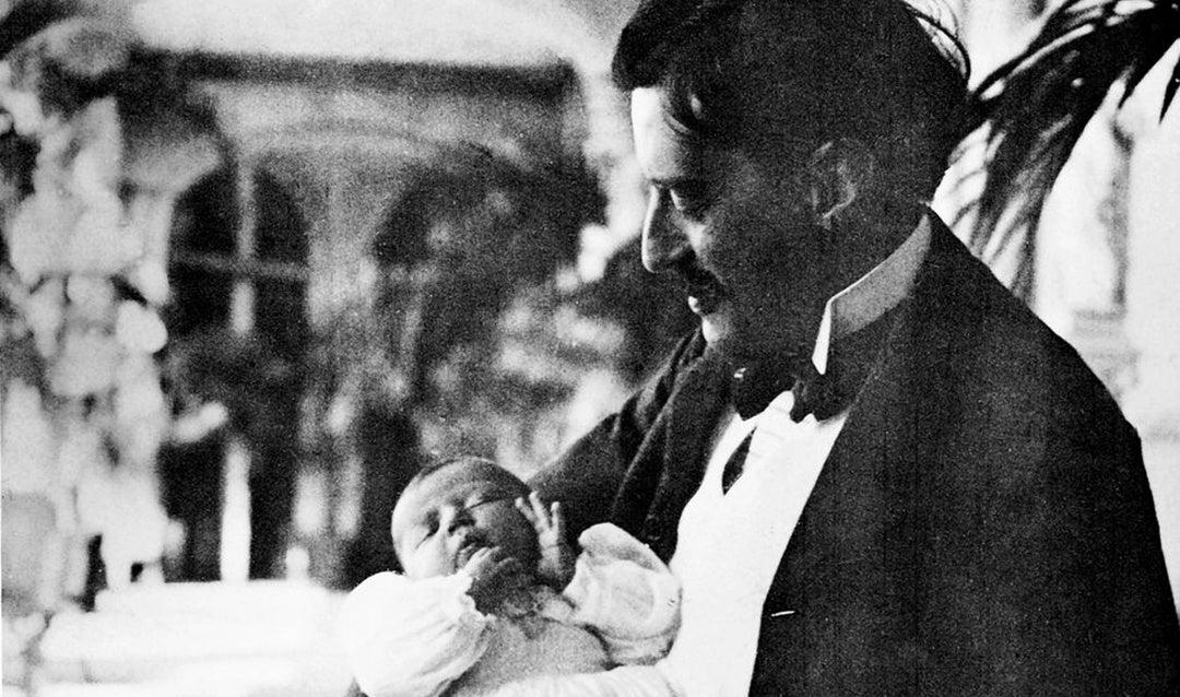 George Vanderbilt with newborn daughter Cornelia on the Loggia of Biltmore House, September 30, 1900