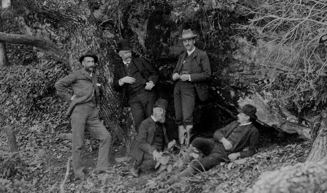 Landscape architect Fredrick Law Olmsted (seated, center) and George Vanderbilt (standing, center-right) with other key Biltmore figures, 1892