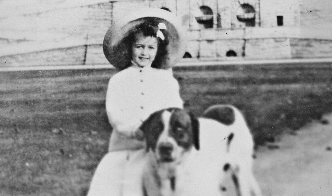 Cornelia Vanderbilt with one of her family's Saint Bernards on the Front Lawn of Biltmore House, 1905
