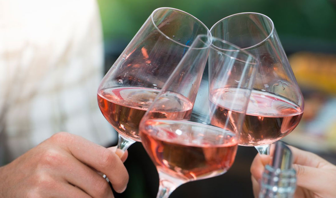 Toasting with glasses of rosé